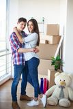 Happy young couple moving together in new apartment stock photos