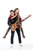 Happy young couple of musicians with microphone and electric guitar performing music together Stock Photos
