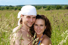 Happy young couple in nature Stock Images