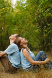Happy young couple in nature. Happy young loving couple relaxed in summer nature Stock Image
