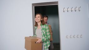Happy young couple in a new apartment. Moving concept