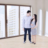 Happy young couple at new apartment Stock Images