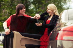 Happy young couple by new car Royalty Free Stock Image