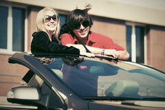Happy young couple in new car Royalty Free Stock Photo
