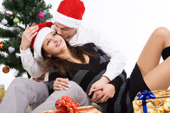 Happy young couple, in a New Year's situation Royalty Free Stock Photos