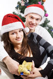 Happy young couple, in a New Year's situation Stock Photos