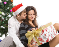 Happy young couple, in a New Year's situation Stock Image