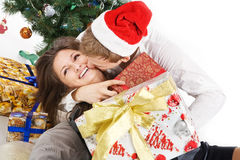 Happy young couple, in a New Year's situation Stock Images