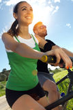 Happy Young Couple On A Bike Ride In The Countryside Royalty Free Stock Photo