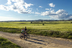 Happy Young Couple On A Bike Ride In The Countryside Royalty Free Stock Photos