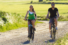 Happy Young Couple On A Bike Ride In The Countryside Stock Image