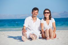 Happy Young Couple On The Beach Royalty Free Stock Images