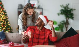 Happy couple opening presents on Christmas morning royalty free stock images