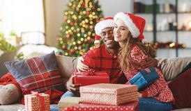Happy couple opening presents on Christmas morning stock photos