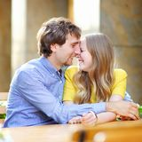Happy young couple in the outdoor cafe Royalty Free Stock Images