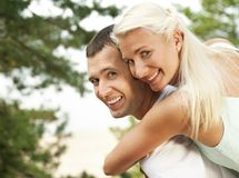 Happy young couple outdoors Royalty Free Stock Image
