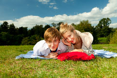 Happy young couple outdoors Stock Image