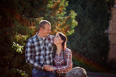Happy young couple outdoors on beautiful autumn day. Love, rela Royalty Free Stock Photography