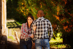 Happy young couple outdoors on beautiful autumn day. Love, rela Royalty Free Stock Photo