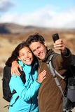 Happy young couple outdoors hiking Stock Photo