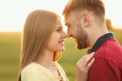 Young couple outdoors on sunny spring day Royalty Free Stock Photography