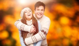 Happy young couple over autumn background Stock Photos