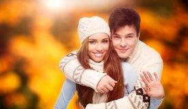 Happy young couple over autumn background Royalty Free Stock Photos