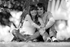 Happy young couple in park. B/W photo Royalty Free Stock Photography