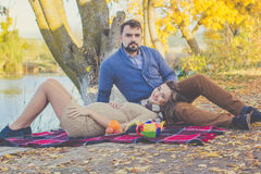 Happy young couple on the picnic in autumn park Royalty Free Stock Images