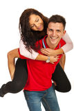 Happy young couple in piggyback Royalty Free Stock Images