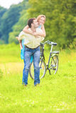 Happy Young Couple Piggyback Having Fun Outdoors Royalty Free Stock Photo