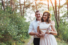 Happy young couple in a pine forest in summer stock image