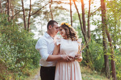 Happy young couple in a pine forest in summer royalty free stock photos
