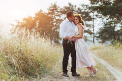 Happy young couple in a pine forest in summer stock images