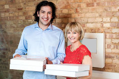Happy young couple with pizza boxes Royalty Free Stock Photo