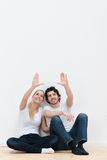 Happy young couple plan their new decor Stock Photos