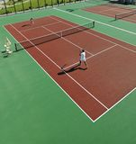 Happy Young Couple Play Tennis Game Outdoor Royalty Free Stock Images
