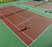 Happy young couple play tennis game outdoor Royalty Free Stock Photography