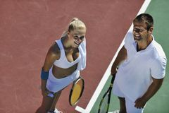 Happy young couple play tennis game outdoor Royalty Free Stock Photos