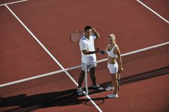 Happy young couple play tennis game outdoor stock photos