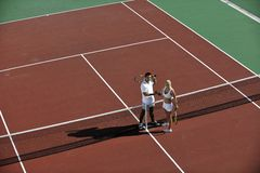 Happy young couple play tennis game outdoor Stock Image