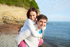 Happy young couple  playing on beach Royalty Free Stock Photos