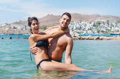 Happy young couple playing in the sea Royalty Free Stock Image