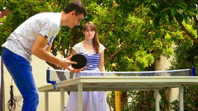 Happy young couple playing table tennis stock video