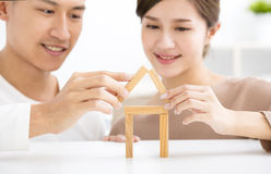 Happy young couple playing with toy blocks Stock Photography