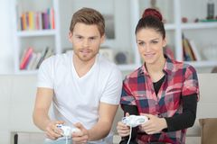 Happy young couple playing video games. Couple Stock Photo