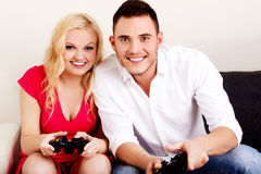 Happy young couple playing video games Royalty Free Stock Photography