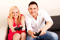 Happy young couple playing video games Stock Photo
