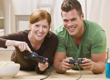 Happy Young Couple Playing Video Games Royalty Free Stock Images