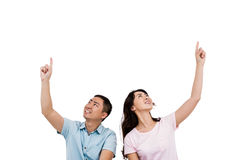 Happy young couple pointing up Royalty Free Stock Photo